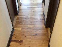natural hickory wood floor in hallway