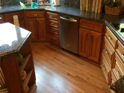 natural red oak trim work dishwasher