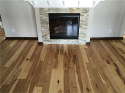 new hickory floor around a fireplace