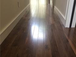hallway with prefinished walnut wood flooring